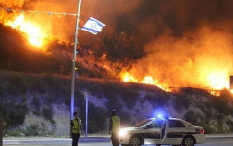 من الحرائق التي أشعلتها البلالين الحارقة الفلسطينية في الأراضي المحتلة - صورة أرشيفية